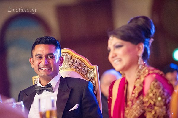 indian-wedding-reception-groom-looks-at-bride-suraj-malathi