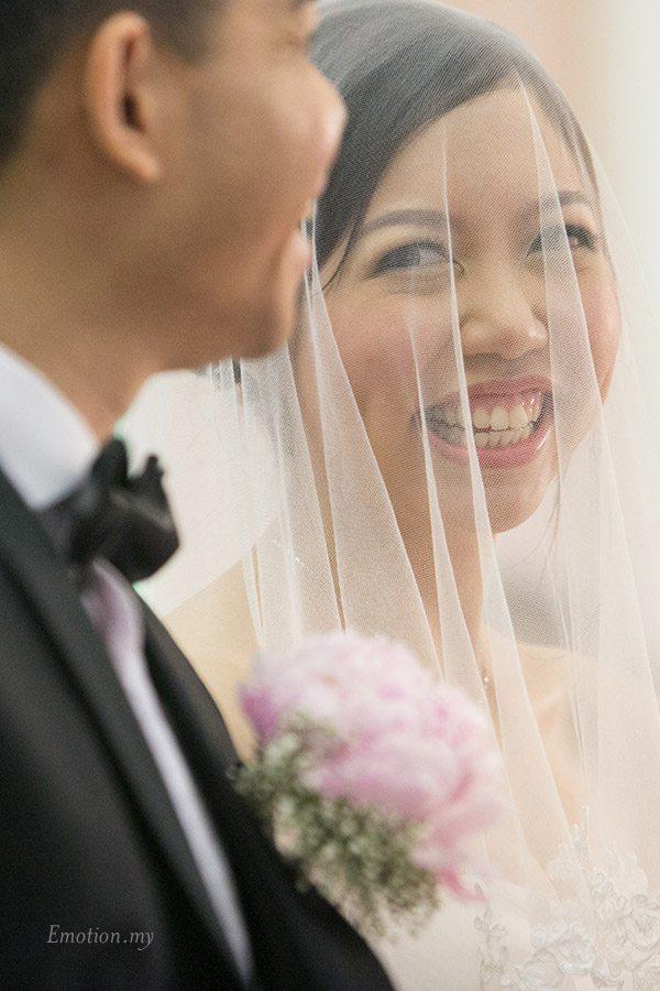 christian-wedding-bride-looks-at-groom-edward-tzeteng