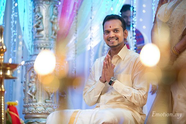 malayali-wedding-groom-smiling-sanjeev-reshmi