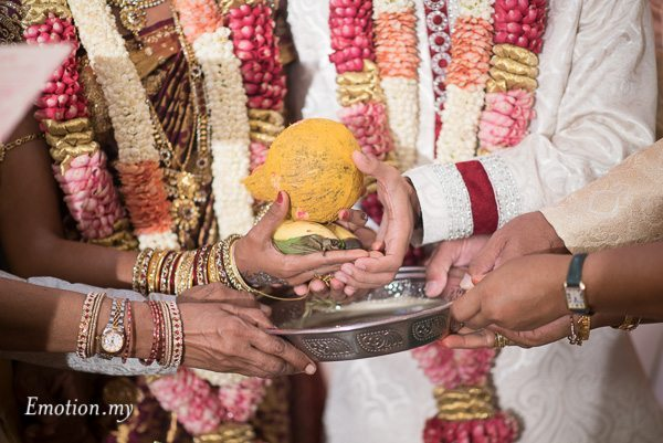 hindu-tamil-wedding-ceremony-coconut-hands-malaysia-raymond-darshini